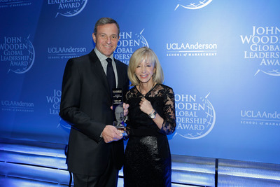 The Walt Disney Company Chairman and CEO Robert A. Iger and UCLA Anderson School of Management Dean Judy Olian at the 2013 John Wooden Global Leadership Award dinner.  (PRNewsFoto/UCLA Anderson School of Management)