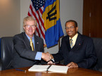 Stephen P. Holmes, Chairman and Chief Executive Officer, Wyndham Worldwide, and Everton Walters, Chairman, Barbados Tourism Investment Inc., finalize agreement to develop 450-room Sam Lord's Castle Barbados, A Wyndham Grand Resort.