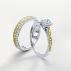 Israel Diamond Deals from the Leibish & Co Touche de Couleur collection. Both the engagement and wedding rings feature colorless and fancy intense yellow side diamonds, mounted in 18K white and yellow gold. Center stone is GIA certified.