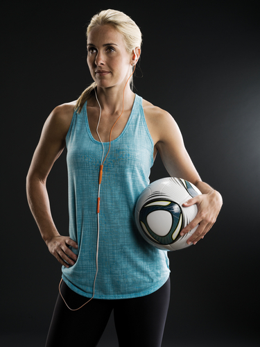 Soccer superstar Heather Mitts and her Polk Audio UltraFit 3000 headphones.  (PRNewsFoto/Polk Audio, Alan ...