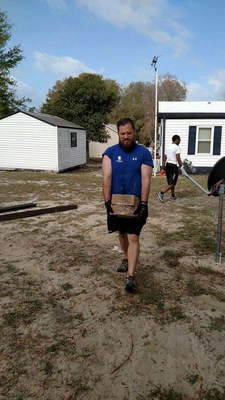 Wounded Warrior Project Alumni and The Mission Continues renovate a veterans home during a service project.