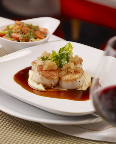 Oven roasted Atlantic Sea Scallops with celery root puree, apple chutney.  (PRNewsFoto/Wynn Las Vegas)
