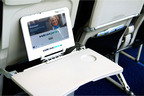 The new TrayVu Slim(TM) portable inflight entertainment with unique clip allows full use of meal tray while watching a movie. Developed by Skycast Solutions, founded by Bill Boyer, inventor of the digEplayer, the world's first portable IFE offering. www.skycastsolutions.com.  (PRNewsFoto/Skycast Solutions)
