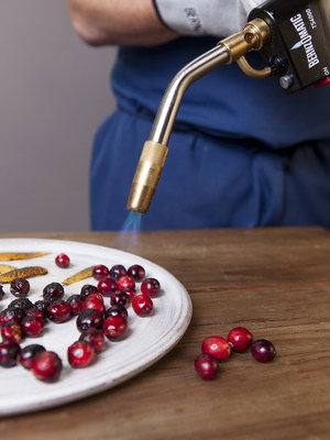 Chef John Sundstrom of Lark Seattle uses a Bernzomatic blowtorch to char cranberries for his Blistered Cranberry Sauce Thanksgiving recipe. (Photo credit: Zack Bent)