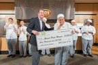 John Buckner, vice president of marketing for S&D Coffee and Tea, presents the $5,000 grand prize check to Johnson & Wales University freshman Gillian Howard for winning the 2015 S&D Culinary Challenge, Feb. 24, 2015.