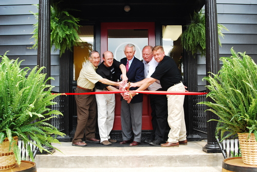 Kentucky Governor Steve Beshear and officials from Barton 1792 Distillery cut the ribbon to open the Barton 1792 Distillery Visitor Center in Bardstown, KY. Pictured from left to right, Chuck Braugh, former Barton Plant Manager and present for the original Visitor Center opening in 1967; Mark Brown, President and CEO, Sazerac Co.; Kentucky Governor  Steve Beshear; Johnnie Colwell, Vice President of Operations, and Ken Pierce, Master Distiller. Photo Source: Barton 1792 Distillery.  (PRNewsFoto/Barton 1792 Distillery)