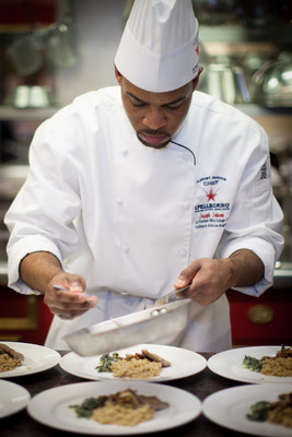 S. Pellegrino Almost Famous Chef Competition 2012 West regional competition winner, Joseph Johnson, puts the last touches on his dish for the Mystery Basket competition during the Finals competition in Napa Valley, Calif.