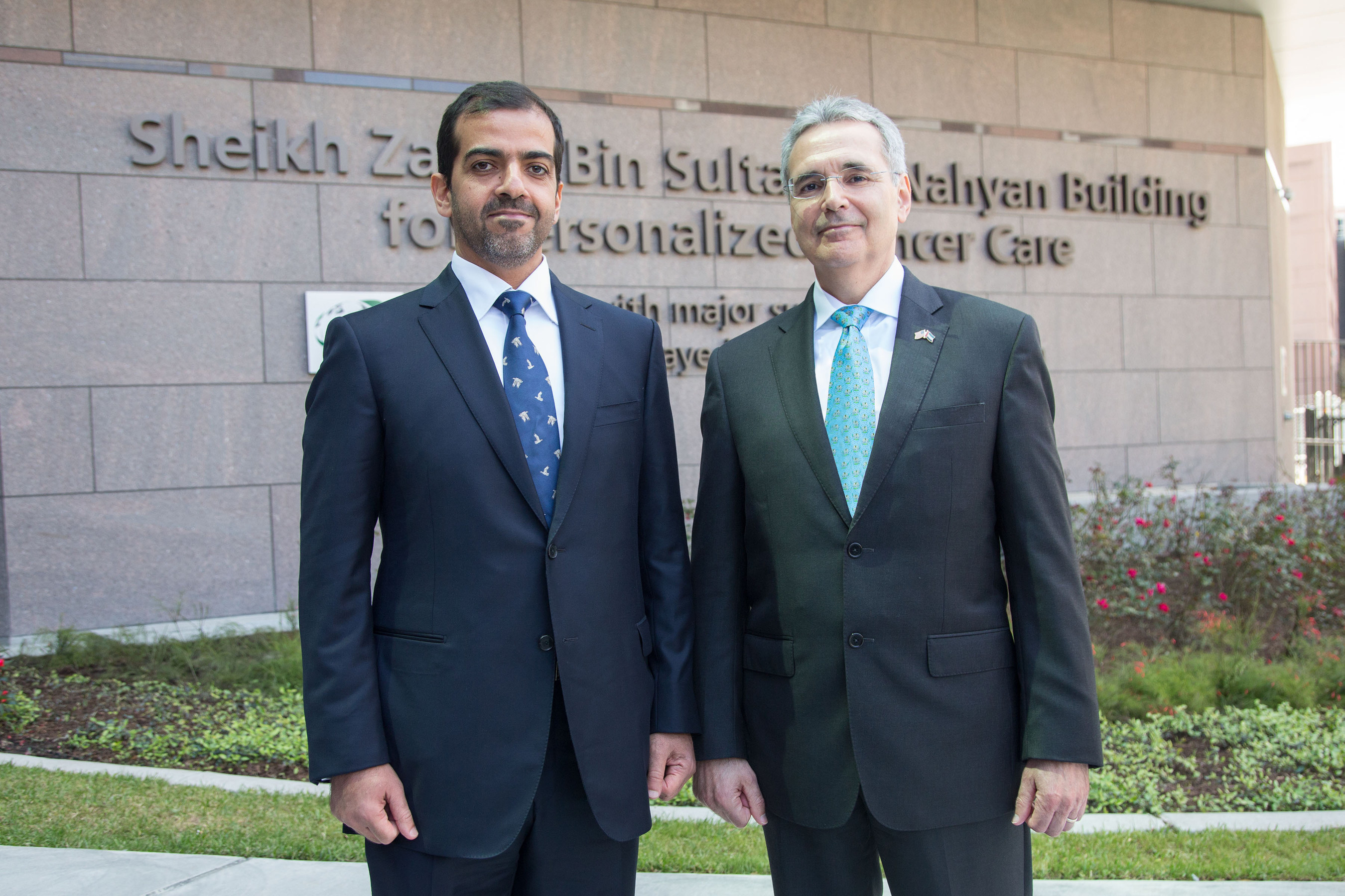 His Highness Sheikh Hamed Bin Zayed Al Nahyan, Chairman of the Crown Prince Court of Abu Dhabi, left, and Ronald A. DePinho, President, The Universty of Texas D Andreson Cancer Center, pose for a photo in front of the Sheikh Zayed Bin Sultan Al Nahyan Building for Personalized Cancer Care, after the center was dedicated Friday, April 8, 2016