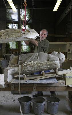 Jim Neel opening a mold in the Kohler Co. Pottery, 2009. (PRNewsFoto/The John Michael Kohler Arts Center) (PRNewsFoto/THE JOHN MICHAEL KOHLER ARTS)