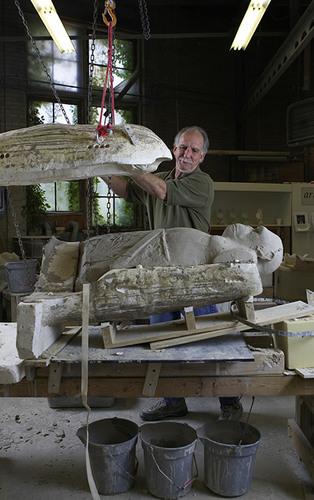 Jim Neel opening a mold in the Kohler Co. Pottery, 2009.  (PRNewsFoto/The John Michael Kohler Arts Center)