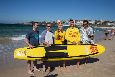 LA Dodgers with surf lifesavers on Bondi Beach (Drew Butera, Tim Federowicz, Mike Baxter, Chris Withrow).  (PRNewsFoto/Destination New South Wales)