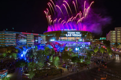 Fireworks illuminate T-Mobile Arena and The Park, a dining and entertainment district leading up to the arena from the Las Vegas Strip. Bliss Dance, lit in blue, is one of The Park's inspiring art installations and was designed by artist Marco Cochrane to embody feminine power. Photo credit: Al Powers