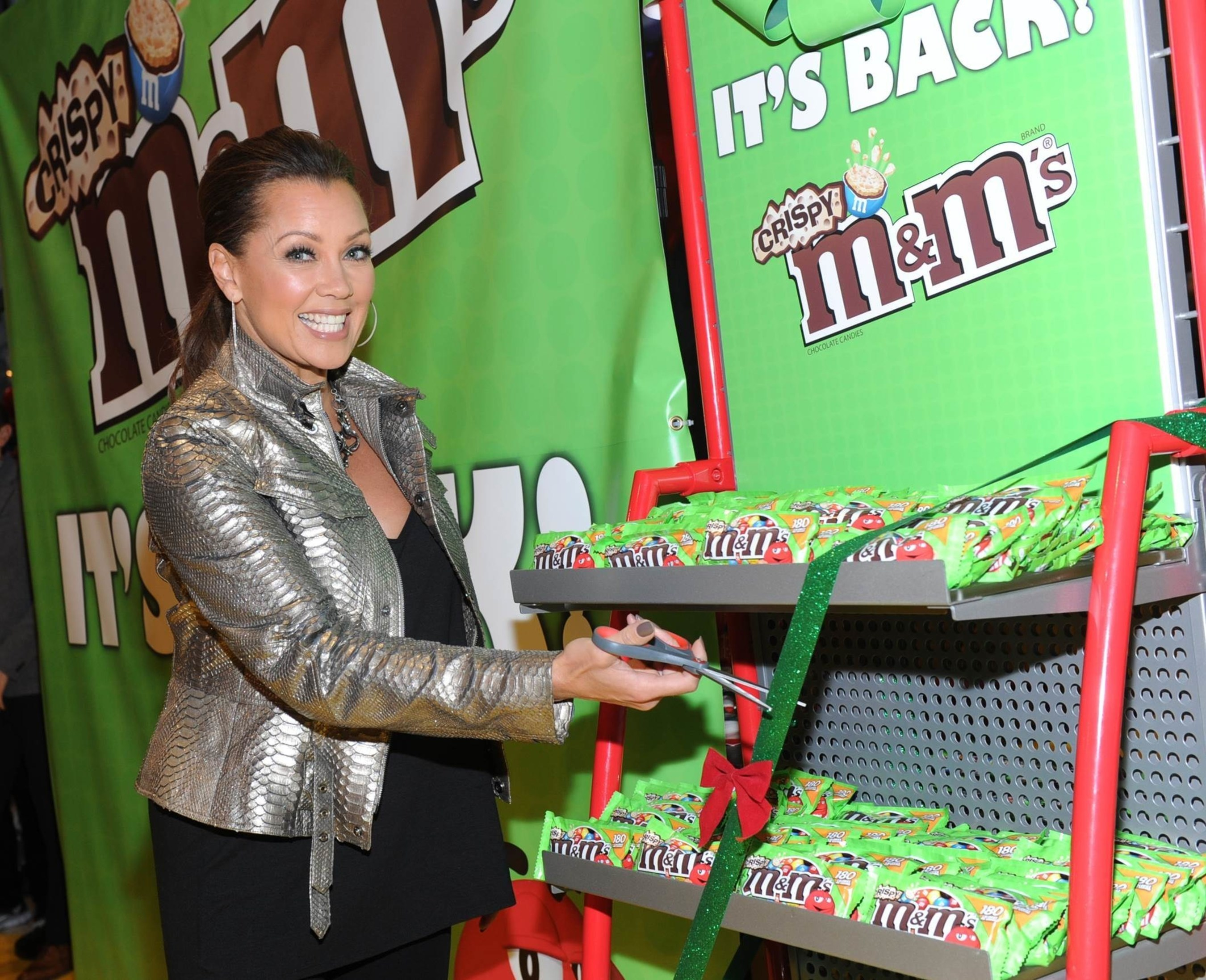 (December 9, 2014) Vanessa Williams, the multi-talented entertainer and voice behind M&M'S(R) Brand spokescandy Ms. Brown, unveils the first tubes of M&M'S(R) Crispy on the famous M&M'S World(R) Candy Wall featured at the store in Times Square. (Photo by Diane Bondareff for Mars Chocolate North America)