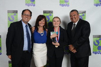 Hal Snyder, Co-Chair, California State Science Fair Board and a Vice President at SoCalGas, and Liz Snyder, Co-Chair, California State Science Fair Board, stand with Project of the Year (Senior Division) winner Shiloh Curtis, and Frank Flores, a Vice President at Northrop Grumman during the 63rd annual California State Science Fair award ceremonies.  (PRNewsFoto/California Science Center...)