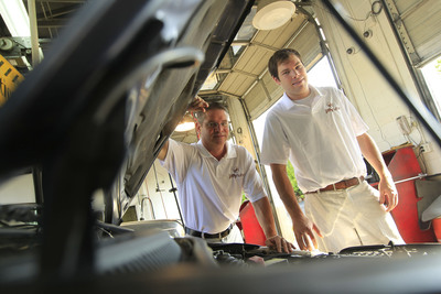 Butch Barclay, a Jiffy Lube franchisee, and his son, Austin, experience firsthand the role fathers play in passing down vehicle maintenance knowledge to their children. Courtesy of Benjamin Krain/Getty Images. (PRNewsFoto/Jiffy Lube International)