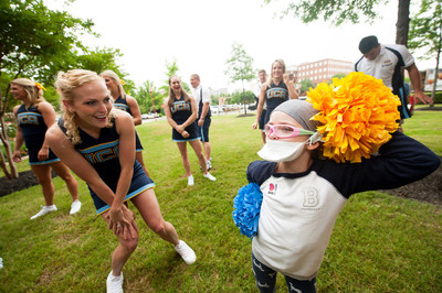 Varsity Spirit Cheerleaders visit with St. Jude patients to bring them smiles and cheerful times.