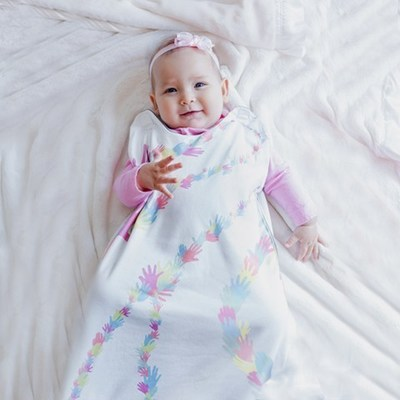 Little Lotus Sleeping Bag, featuring NASA-inspired fabric, shown in Lotus Signature Print. Photo Courtesy of Embrace Innovations
