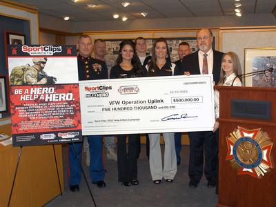 "Sport Clips Haircuts presents a $500,000 check to the Veterans of Foreign Wars' Operation Uplink free call day program on December 10, 2012. The funds were raised by more than 950 locations nationwide through Sport Clips' Help A Hero program. (Front row from left: U.S. Marine Corps Col. Charles ""Chuck"" Sides, representatives from Sport Clips top fundraising store, Cristina Hermosillo and Crystal Saldivar, VFW National Commander John Hamilton, and Help A Hero Program Manager Margaret Allee.).  (PRNewsFoto/Sport Clips Haircuts)"