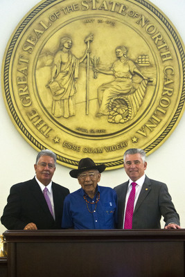 Jerry Wolfe (Center), tribal elder of the Eastern Band of Cherokee Indians, delivered the opening prayer in the Cherokee language at the N.C. Senate session June 19, 2014. Wolfe was named a Beloved Man by the tribal council in April, 2013, an honor which has not been bestowed by the Eastern Band in more than 200 years. Also shown are Eastern Band Vice Chief Larry Blythe (Left) and N.C. Senator Jim Davis (Right). (Photo – Eastern Band of Cherokee Indians)