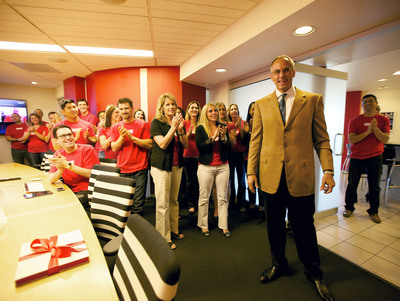 Employees applaud Tim Riester for 25 years in business.