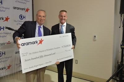 Aramark CEO Eric Foss presents a $750,000 check, accepted by CHOP CEO Steven Altschuler, M.D. on behalf of CHOP's Healthy Weight Program