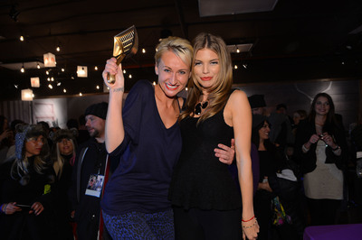 "Balbinka Korzeniowska's film ""A Change of Heart"" won the grand prize at the 2013 Fresh Step Catdance Film Festival. She received the Golden Litter Scoop from actress and Catdance Film Festival host AnnaLynne McCord as well as $10,000.  (PRNewsFoto/Fresh Step Litter, Photo by Mark Davis/Getty Images)"