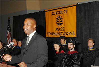 Moses Foster, West Cary Group President and CEO, gives the commencement address at VCU's School of Mass Communications graduation ceremony.  (PRNewsFoto/West Cary Group)