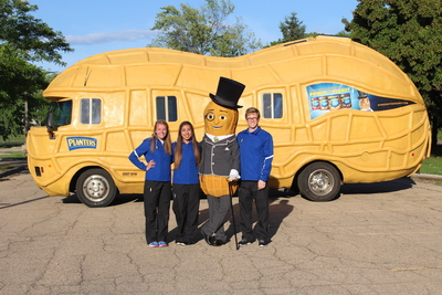 Mr. Peanut and the Planters Peanutters stand outside one of two new Planters NUTmobiles