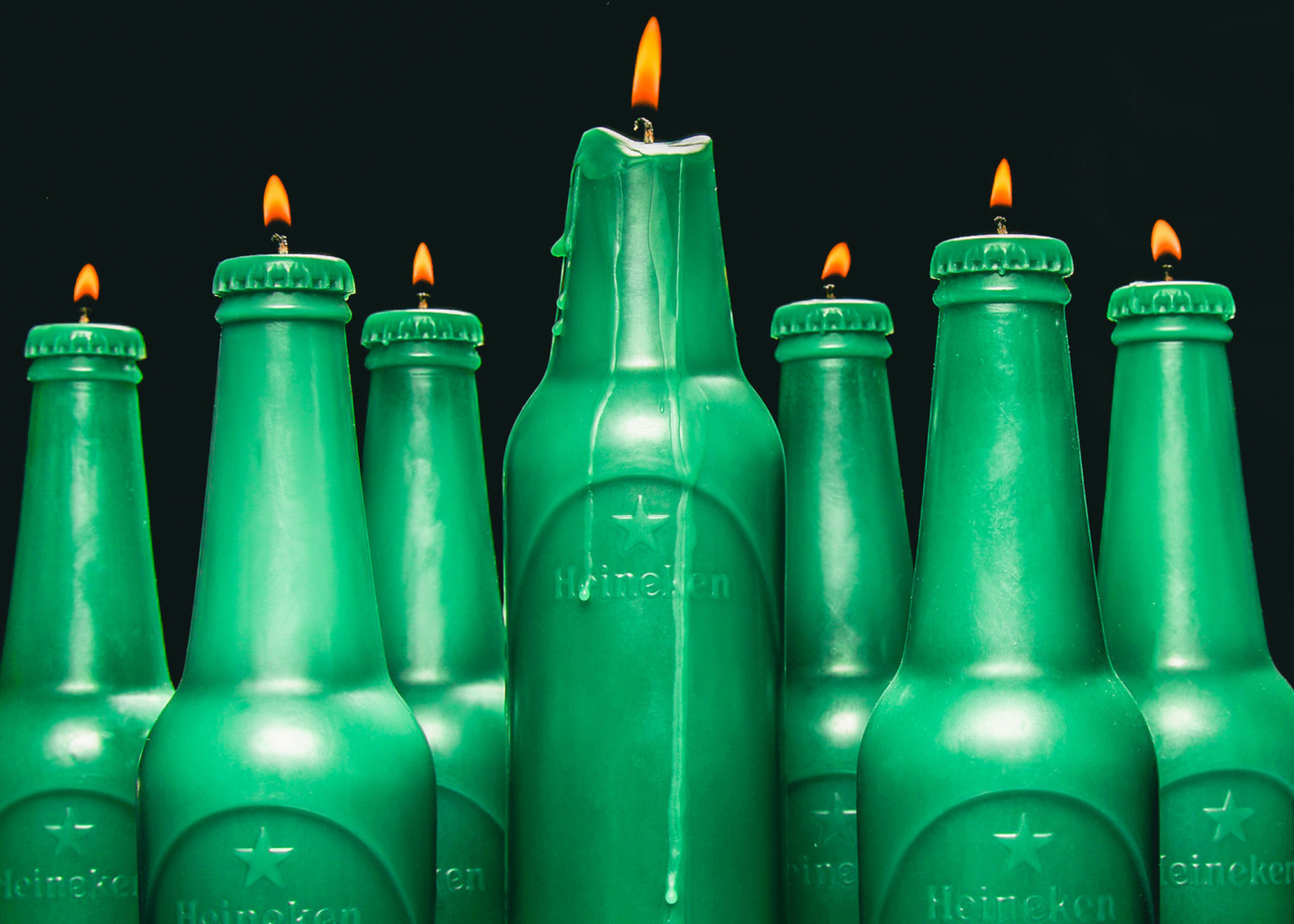 HEINEKEN and Miami's Alchemist introduce six-pack of handmade candles for #Heineken100 program.