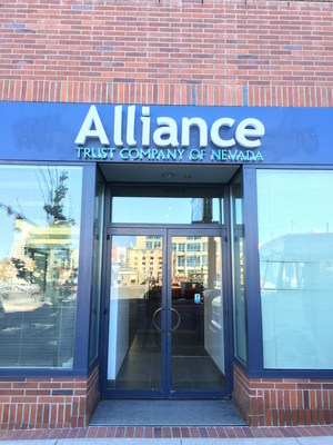 The front door of Alliance Trust Company's new office located in the Museum Tower in downtown Reno.