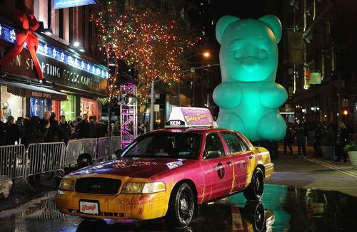 A giant Candy Bear and people with Candy heads appear on the streets of New York City to celebrate the launch of King's Candy Crush Soda Saga (PRNewsFoto/King Digital)