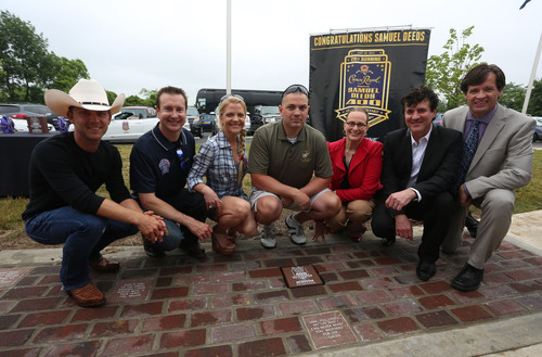 "Country music singer Justin Moore, NASCAR driver Kurt Busch, Armed Forces Foundation President and Executive Director Patricia Driscoll, Crown Royal Brand Director Abby Wise, Big Machine Label Group Founder and CEO Scott Borchetta and Indianapolis Motor Speedway COO Doug Boles pose with Retired Gunnery Sergeant Samuel Deeds (center), winner of Crown Royal's ""Your Hero's Name Here"" program, behind the replica Yard of Bricks in Erlanger, Ky. on Thursday, June 27, 2013. As winner, Deeds will receive naming rights to the NASCAR ..."