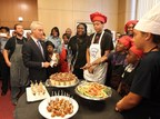 Mayor Rahm Emanuel enjoys lunch prepared by the kids of Bella Cuisine Kid's Cooking Club, and their police officer partners last Wednesday at City Hall.  Latrice McArthur, founder of Bella Cuisine is pictured at right in black.  The program is the winner of a Peace Grant from the Emerson Collective