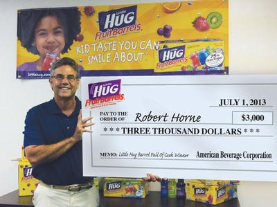 Tim Barr, Vice President of Marketing for Little Hug, presents $3,000 check to prize winner Robert Horne.