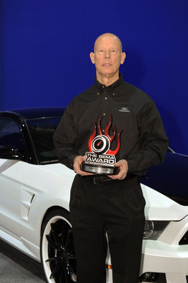 Ken Czubay, Ford Vice President US Marketing Sales and Service with a 2012 SEMA Award for the Ford Mustang named Hottest Car.  (PRNewsFoto/The SEMA Show)