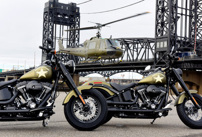 """A UH-1 """"Huey"""" helicopter lands behind two Harley-Davidson Softail Slim S motorcycles to escort veterans to America's Parade in New York on Veterans Day, Wednesday, Nov. 11, 2015, in Kearny, NJ.  Harley-Davidson announced the extension of """"Operation Personal Freedom: Ride Free,"""" free Riding Academy motorcycle training to all active-duty military and veterans. (Photo by Diane Bondareff/AP Images for Harley-Davidson) (PRNewsFoto/Harley-Davidson Motor Company)"""