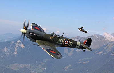 """Yves """"Jetman"""" Rossy took to the skies with fellow """"Breitling Flyer"""" pilot, Nigel Lamb in the renowned Spitfire MH434, Bex, Switzerland, September 7, 2012. Photo by Marie Schenk.  (PRNewsFoto/Breitling, Marie Schenk)"""