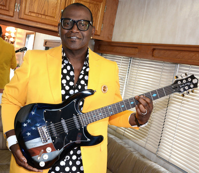"""Randy Jackson shows off his new """"American Tribute Collection"""" guitar before its debut on HSN May 25.  (PRNewsFoto/HSN)"""