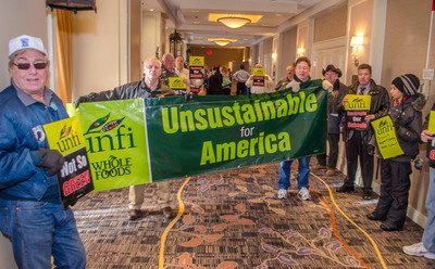 Educators, consumers, and labor and environmental activists gathered today to protest the unsustainable practices of organic food distributor United Natural Foods Inc. (UNFI) and retail partner Whole Foods Market (WFM) at UNFI's annual shareholder meeting.  (PRNewsFoto/International Brotherhood of Teamsters)