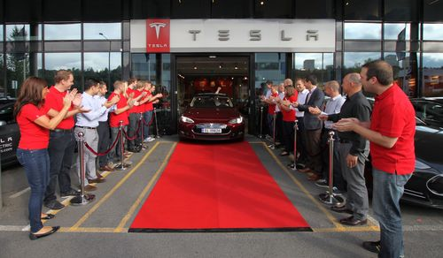 First European customer Frederic Hauge driving off with his Model S today (PRNewsFoto/Tesla Motors Ltd)