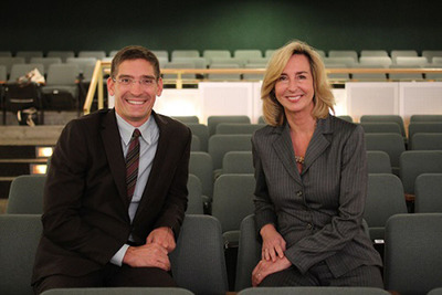 Commonwealth Shakespeare Company Founding Artistic Director Steven Maler, left, and Babson College President Kerry Healey celebrate new partnership in Babson's Sorenson Theater.  (PRNewsFoto/Babson College)