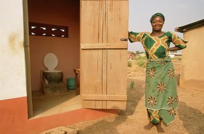Rakiya Abdullah next to her latrine, Sagnarigu, Tamale, Northern Region, Ghana. (PRNewsFoto/WaterAid, Jon Spaull) (PRNewsFoto/WATERAID)
