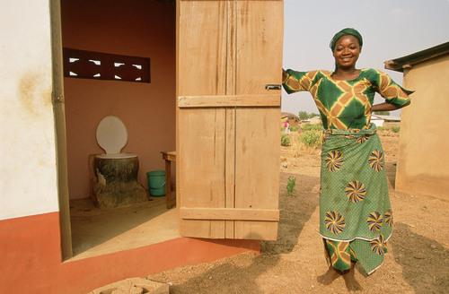Rakiya Abdullah next to her latrine, Sagnarigu, Tamale, Northern Region, Ghana. (PRNewsFoto/WaterAid, Jon ...