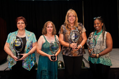 Senior Helpers(R)2013 Caregiver of the Year Award winners: (left to right) Vivian Keslar, Debbie Boone, Patti Haggard and Evonnae Buford pose with their trophies at the annual conference in Austin, Texas.  (PRNewsFoto/Senior Helpers)