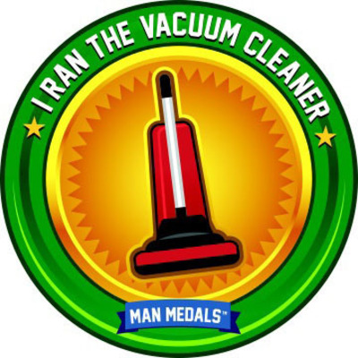 "The number one ""Man Medal"" worthy thing women want from their man? Run the vacuum.  (PRNewsFoto/Man Medals)"