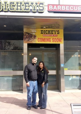 Richard and Julie Foiles stands outside their new Dickey's Barbecue Pit in Buena Park. Grand opening kicks off on Thursday with gift card giveaways.