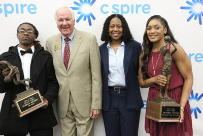 Ole Miss senior guard Stefan Moody and Mississippi State sophomore guard Victoria Vivians were named the best male and female college basketball players in Mississippi by a panel of newspaper, TV and radio reporters and editors who cover the sport.  Moody, left, won the C Spire Howell Trophy, named after former Mississippi State and NBA great Bailey Howell, second from left, and Vivians, right, won the C Spire Gillom Trophy, which is named after Peggy Gillom-Granderson, second from right, Ole Miss'...