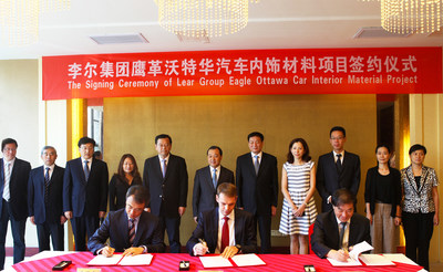 Lear Corporation Signing Ceremony with Administrative Commission of Yangzhou Economic & Technological Development Zone. First row from left to right: Haydon Zhu (VP of Finance, Eagle Ottawa Asia and Lear ASEAN), Carsten Pfuhl (CFO Asia, Lear Corporation) and  Xi Chen (Director of the Administrative Committee of Yangzhou Economic and Technological Development Zone).