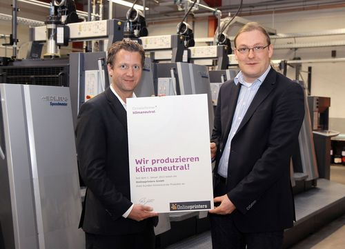 Presentation of certificate: With Moritz Lehmkuhl (left), Managing Director of ClimatePartner, Martin Betz, Technical Operations Manager of Onlineprinters GmbH, has found the right partner for expanding the climate protection commitment of the online print shop and offering climate neutral print products to customers all over Europe. (PRNewsFoto/Onlineprinters GmbH)