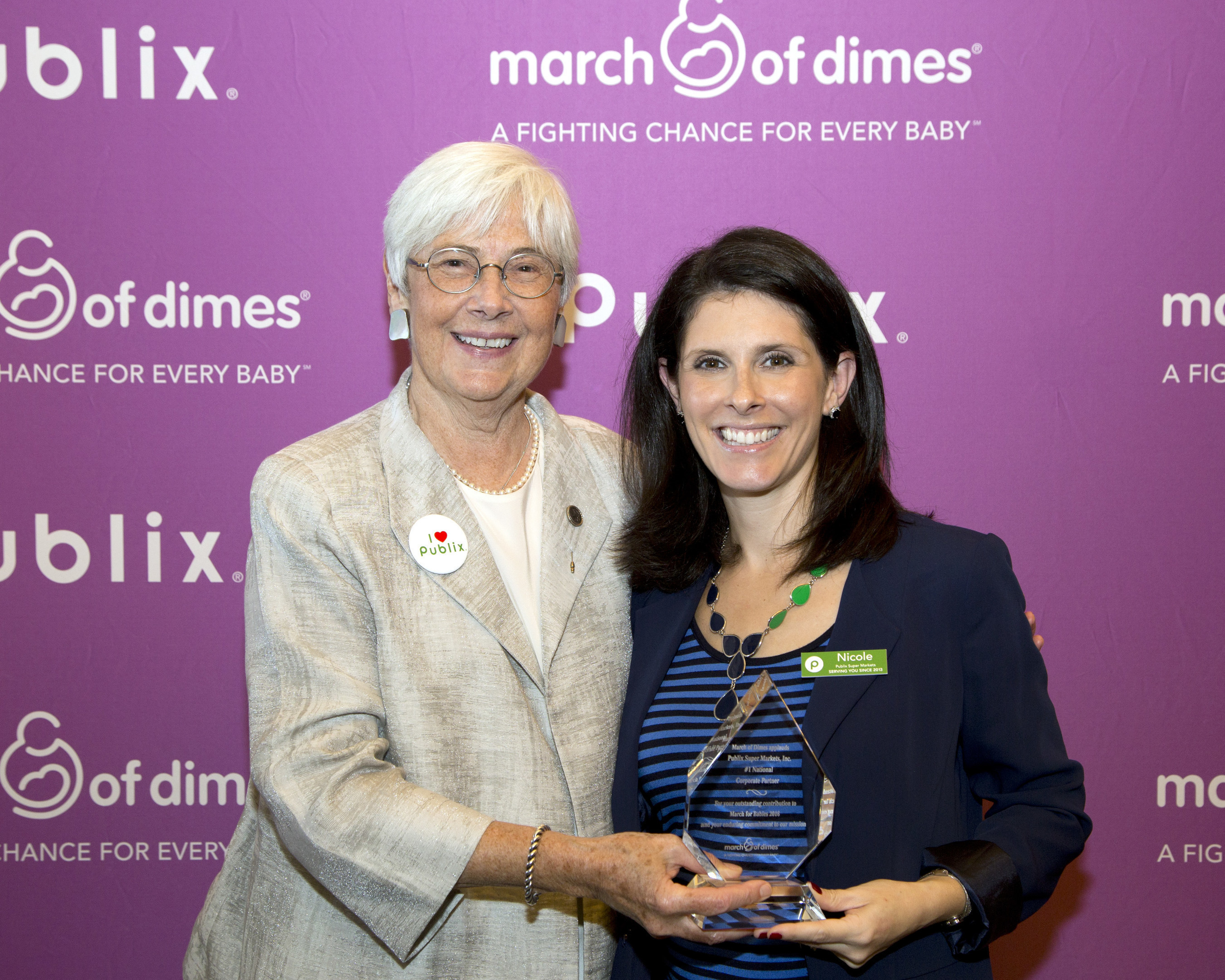 """""""March of Dimes announced Publix Super Markets, based in Lakeland, Florida, is the new number one national 2016 March for Babies corporate partner.  With 1,120 stores in six states, Publix associates and customers raised $7.3 million, bringing their 21-year partnership total to an impressive contribution of $65 million.  Pictured here - Nicole Krauss, Publix Super Markets Media and Community Relations Manager accepting congratulations from March of Dimes President, Dr. Jennifer L. Howse."""""""